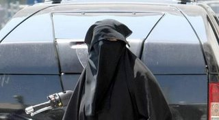Burqa car behind